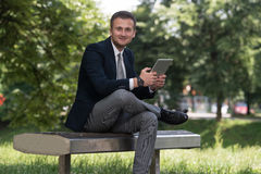 Businessman On A Break With His Computer Stock Images