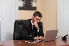 Businessman On A Break With His Computer Royalty Free Stock Photography