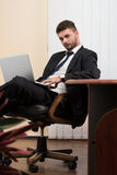 Businessman On A Break With His Computer Royalty Free Stock Image