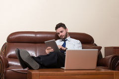 Businessman On A Break With His Computer Stock Photography