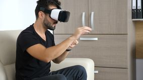 Businessman is taking a break in his office using the VR headset technology stock video