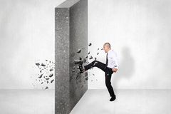 Businessman Break Wall of Obstacle. Business Challenge Conquering Adversity Concept. Businessman breaking wall of obstacle by kick. Business challenge conquering royalty free stock images