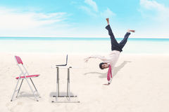 Businessman breakdancing at beach Royalty Free Stock Photos