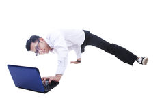 Businessman breakdancing while using laptop Stock Images