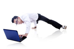 Businessman breakdancing and working Royalty Free Stock Images