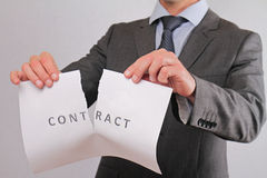 Businessman breaking contract close up. Termination of Contract Stock Photos