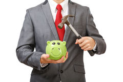 Businessman breaking green piggy bank. With hammer. Part of body. Isolated on white background Stock Photo