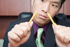 Businessman breaking pencil Stock Photography