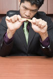 Businessman breaking pencil Royalty Free Stock Images