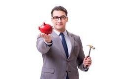 The businessman breaking piggybank isolated white background Stock Photo