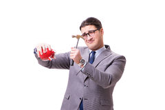 The businessman breaking piggybank isolated white background Royalty Free Stock Images
