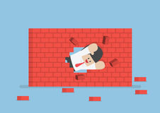 Businessman breaking through the wall Stock Images