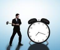 Businessman breaks clock Royalty Free Stock Photography