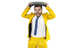 Businessman breaks the computer on his head Stock Photography
