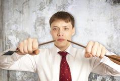 Businessman breaks down arrow Stock Photos