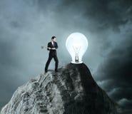 Businessman breaks the light bulb Stock Photos