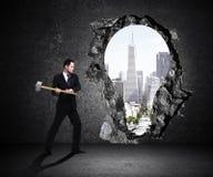 Businessman breaks wall Stock Photography