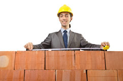 Businessman with bricks Stock Image