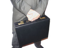 Businessman with briefcase. Businessman holding a breifcase with white background. Overexposed Stock Photography