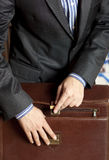 Businessman and briefcase Stock Images