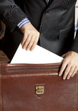 Businessman and briefcase Royalty Free Stock Photography