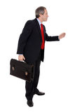 Businessman with briefcase Royalty Free Stock Images