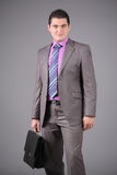 Businessman with a briefcase Stock Images