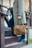 Businessman with briefcase brown leather bag walking upstairs , Stock Photo