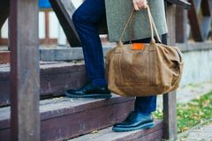 Businessman with briefcase brown leather bag walking upstairs , Stock Image
