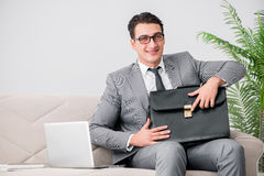 The businessman with briefcase in business concept Stock Photography
