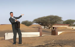 Businessman with a briefcase in  a desert village Stock Photography