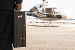 Businessman With Briefcase In Front Of Helicopter Stock Photography
