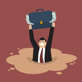 Businessman with briefcase full of money sinking in a quicksand Stock Photography