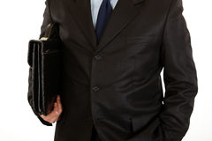 Businessman with briefcase in hand. Close-up. Royalty Free Stock Photos