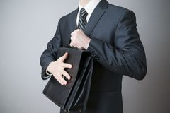 Businessman with briefcase in hand Royalty Free Stock Photos