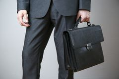 Businessman with briefcase in hand Royalty Free Stock Photo