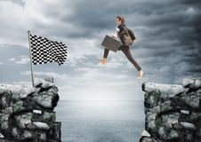 Businessman with briefcase jumping on the rocks to arrive to the checker flag. Digital composite of businessman with briefcase jumping on the rocks to arrive to Stock Photos