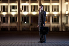 Businessman with briefcase at night city Royalty Free Stock Photo