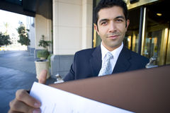 Businessman with briefcase outside of hotel Stock Photography