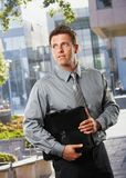 Businessman with briefcase outside office Stock Images