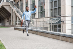 Businessman with briefcase running Stock Photography