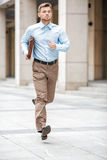 Businessman with  briefcase running. Young businessman with a briefcase running in a city street. Hurrying to work Stock Photo