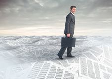 Businessman with briefcase in sea of documents under sky clouds Royalty Free Stock Photos
