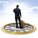 Businessman with a briefcase standing on the clock. 3D illustration Royalty Free Stock Photos