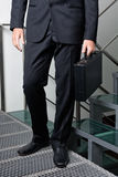 Businessman With Briefcase Standing By Steps stock photos