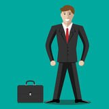 Businessman and briefcase Royalty Free Stock Image