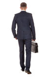 Businessman with briefcase walking away on white stock image