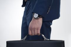 Businessman. With  a briefcase, and watch on the hand Stock Photos