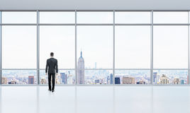 Businessman in bright office Royalty Free Stock Images