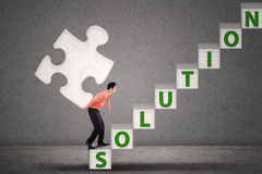 Businessman bring puzzle of solution Royalty Free Stock Photo